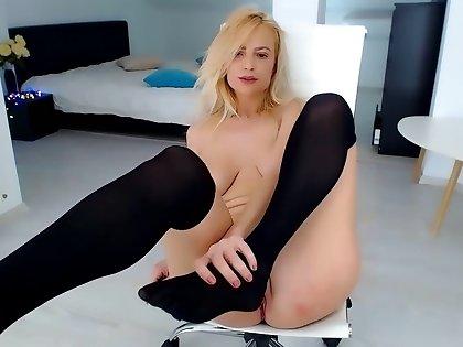 Hot blonde model fingering her pussy