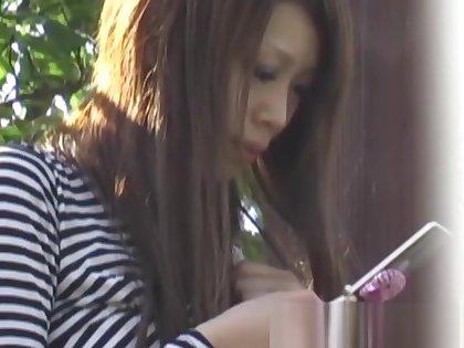 Japanese schoolgirl recorded by kinky voyeur on a street
