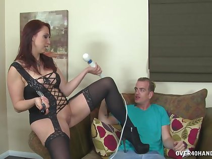 Busty redhead chick Nicki Hunter drops on her knees to on touching a handjob